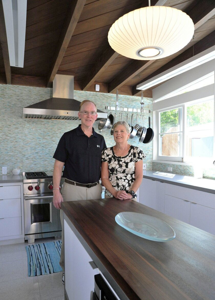 Anne and Richard Kruse in their newly expanded kitchen.