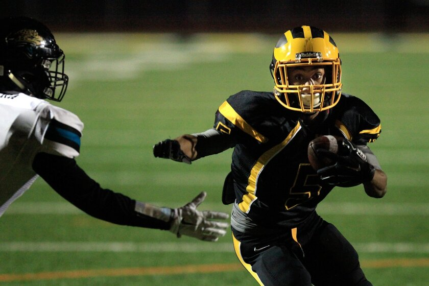 Mission Bay wide receiver Jhavari Ransom has his eyes on the end zone after catching a pass against Valley Center on Friday night.