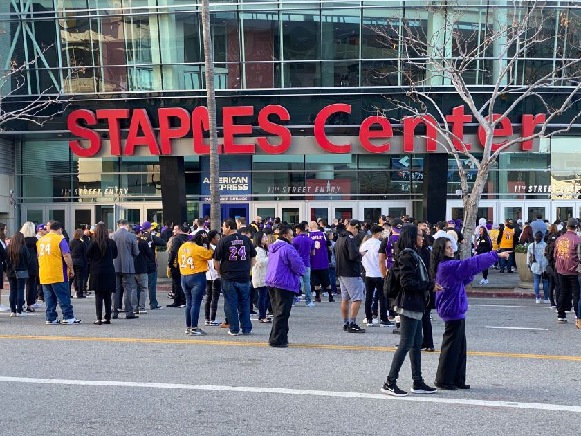 Fans arrive early outside Staples Center for the 'Celebration of Life 'for Kobe and Gianna Bryant Monday morning, February 24, 2020. (Andrew Gombert / Los Angeles Times)