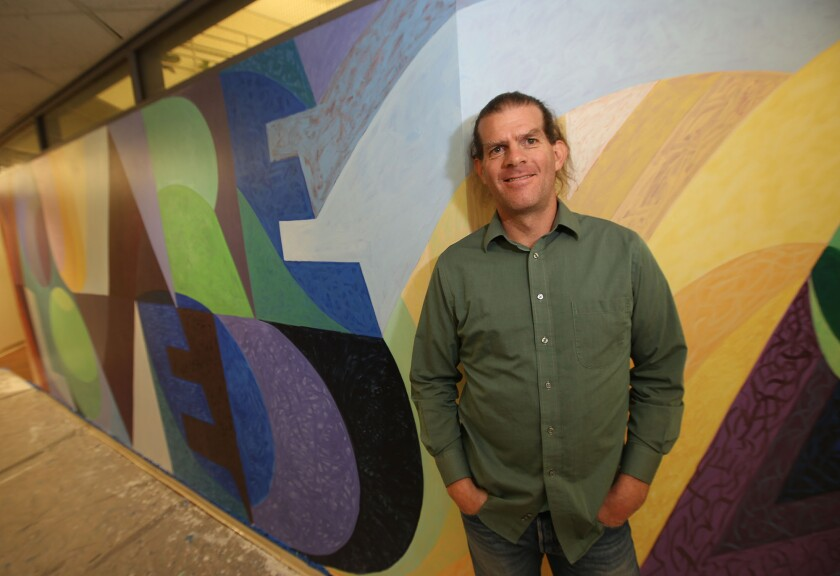 Muralist puts love on the wall at UC Irvine