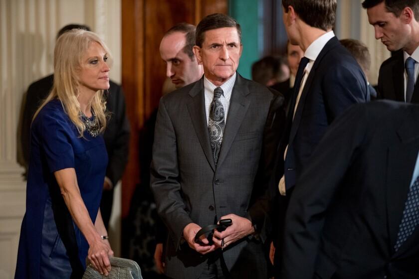 President Trump's national security advisor, Michael Flynn, center, resigned Monday.