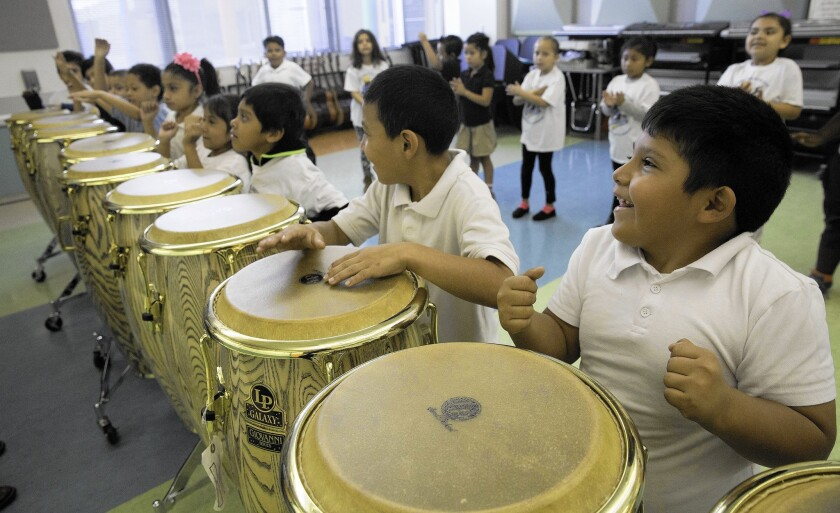 Students play drums in Bladimir Castro's music class at Carlos Santana Arts Academy in North Hills. It is the highest-rated elementary school for arts classes, and more than 90% of its students are low-income.