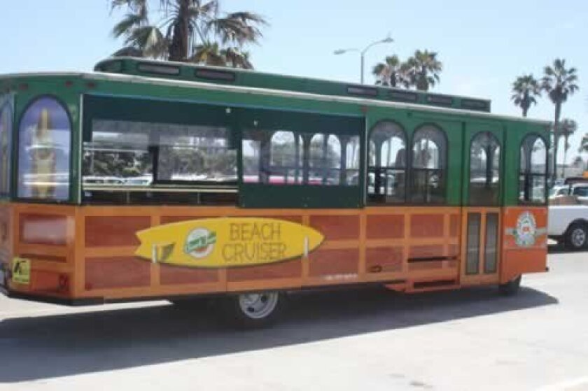 The old Town Trolley's Beach Tour cars are painted to look like Woody vans.