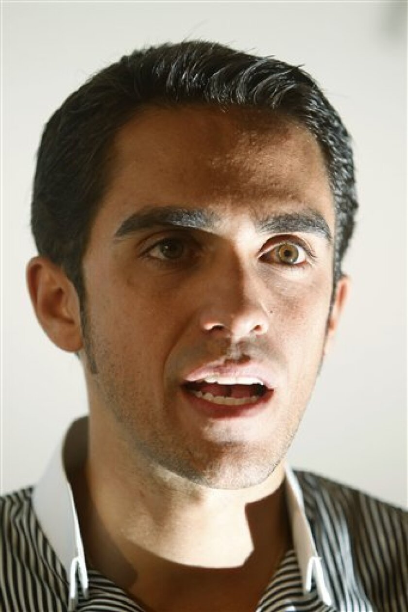 FILE - This Oct. 2, 2010, file photo shows cyclist Alberto Contador of Spain speaking during an interview with the Associated Press in Pinto, on the outskirts of Madrid, Spain. Contador makes a host of claims, from contaminated meat to questionable lab practices, in explaining why he should not be punished for testing positive at this year's Tour de France. (AP Photo/Paul White, File)