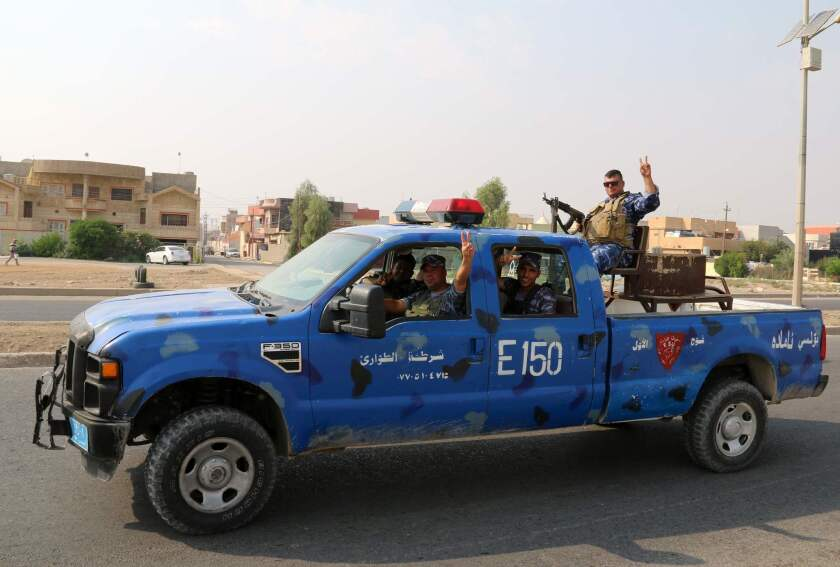 Iraqi police patrol Kirkuk after driving off a counterattack by Islamic State fighters.