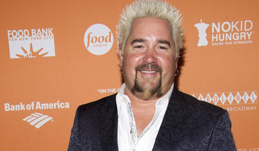 """Guy Fieri, the host of """"Diners, Drive-Ins and Dives,"""" gets poor marks from the New York Times at his new restaurant."""