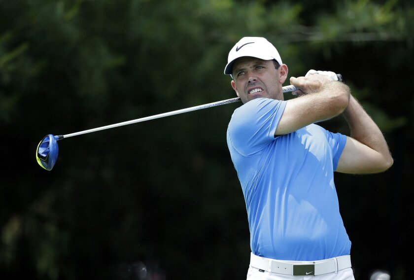 Charl Schwartzel, of South Africa, tees off on the 17th hole during the second round of the Memorial golf tournament, Friday, June 3, 2016, in Dublin, Ohio. (AP Photo/Darron Cummings)