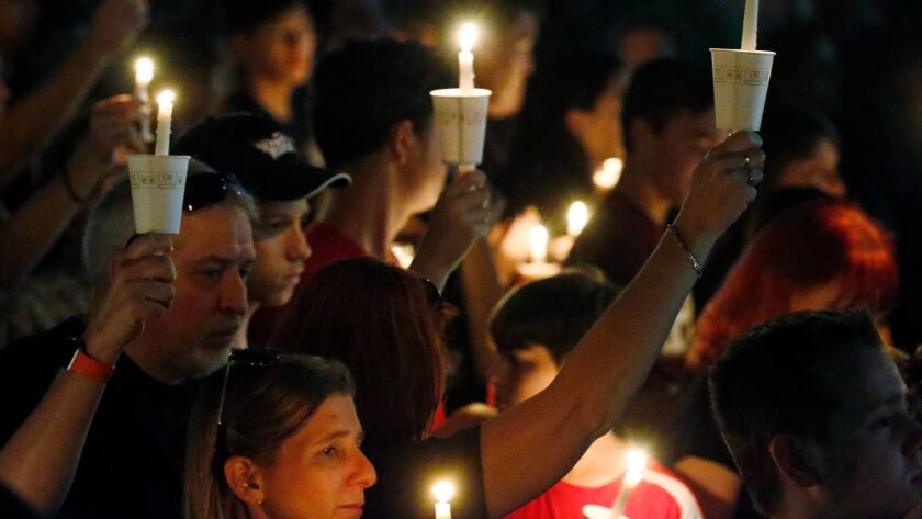 A candlelight vigil for the victims of the shooting at Marjory Stoneman Douglas High School,