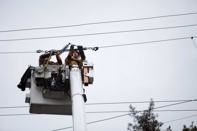 A PG&E crew works to restore power in Felton, Calif.