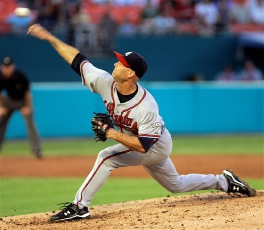 Atlanta Braves' Tim Hudson pitches against the Florida Marlins in the second inning of a baseball game in Miami, Wednesday, July 23, 2008. Hudson left the game after six innings with tightness in his right elbow. The Braves won 9-4. (AP Photo/Alan Diaz)
