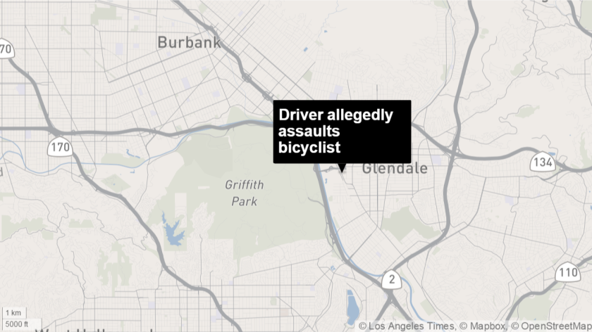 A Glendale woman was arrested Friday after allegedly swerving her car into a bicyclist, police said.