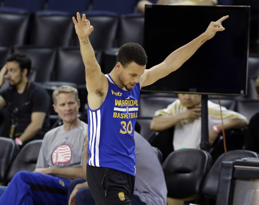 Golden State Warriors' Stephen Curry gestures on the court during NBA basketball practice Wednesday, June 1, 2016, in Oakland, Calif. The Warriors host the Cleveland Cavaliers in Game 1 of the NBA finals on Thursday. (AP Photo/Marcio Jose Sanchez)