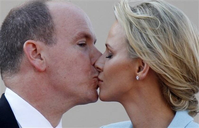 Prince Albert II of Monaco kisses his bride Charlene Princess of Monaco outside the Monaco palace, after the civil wedding marriage ceremony, Friday, July 1, 2011. (AP Photo/Eric Gaillard, Pool)