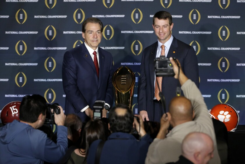 Alabama Coach Nick Saban, left, and Clemson Coach Dabo Swinney