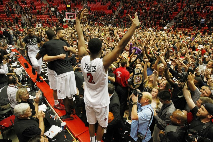 SDSU's Xavier Thames and teammates celebrate with the crowd after beating New Mexico.