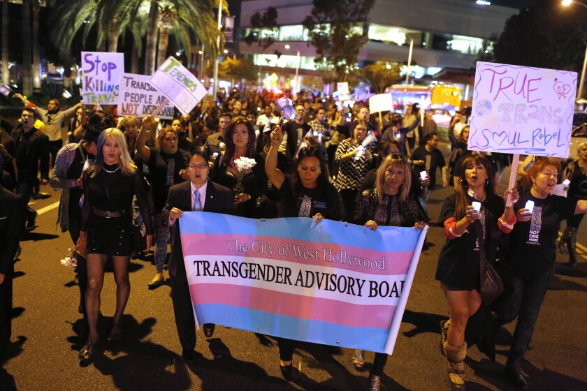 People gather outside the West Hollywood Public Library  to honor Transgender Day of Remembrance.