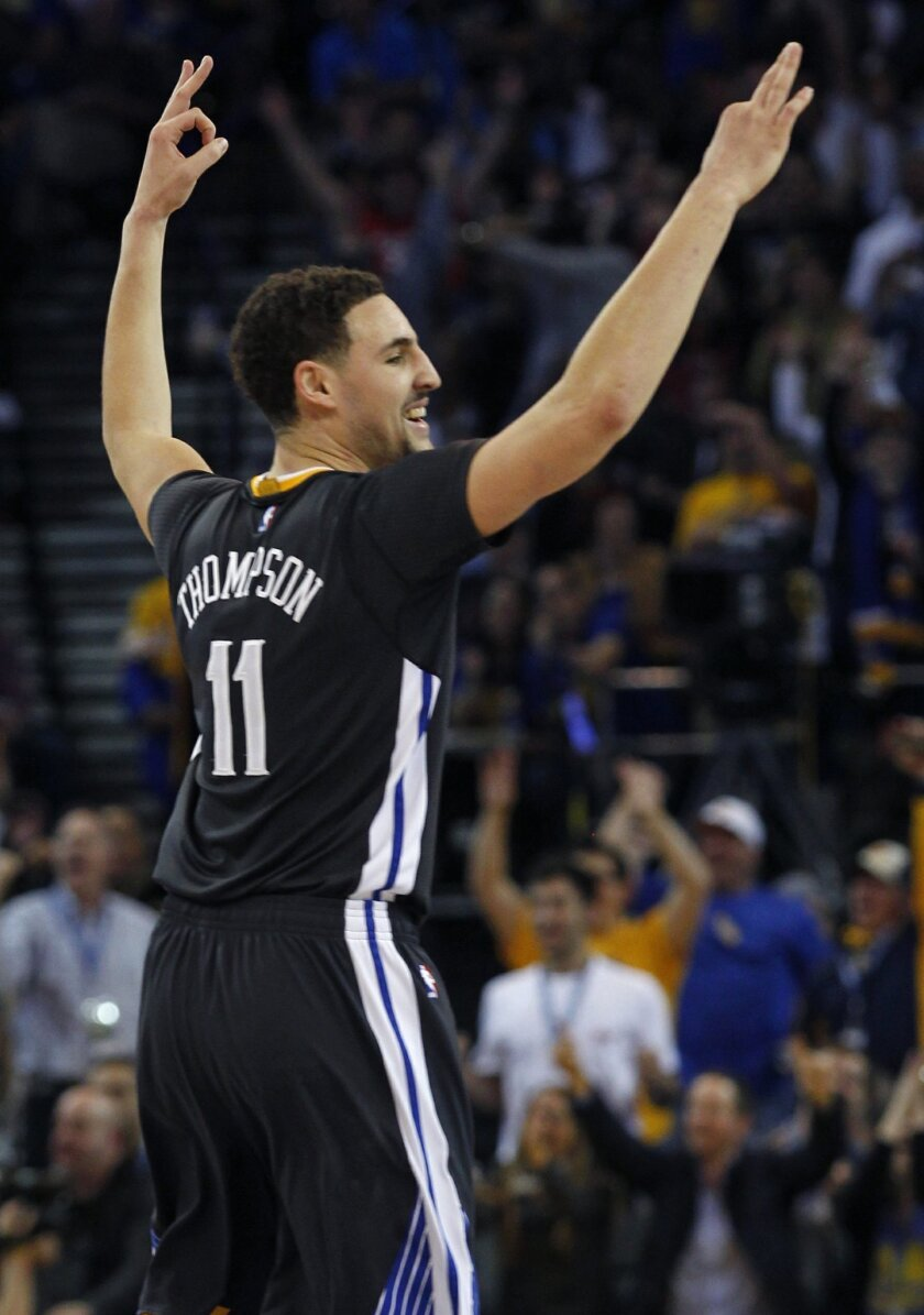 Golden State Warriors' Klay Thompson reacts during the first half of an NBA basketball game against the Oklahoma City Thunder, Saturday, Feb. 6, 2016, in Oakland, Calif. (AP Photo/George Nikitin)
