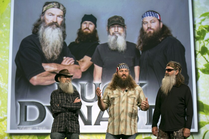 """Robertson family members stand in front of Robertson family members in a promotional appearance for """"Duck Dynasty."""""""