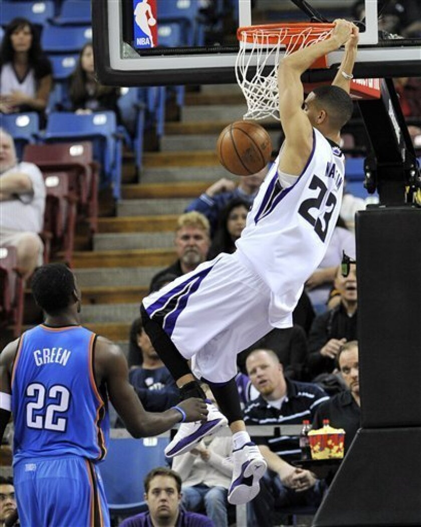 Sacramento Kings' Kevin Martin dunks in front of Oklahoma City Thunders' Jeff Green (22) during the first half of an NBA basketball game in Sacramento, Calif., Sunday, Feb. 1, 2009. (AP Photo/Thearon W. Henderson)