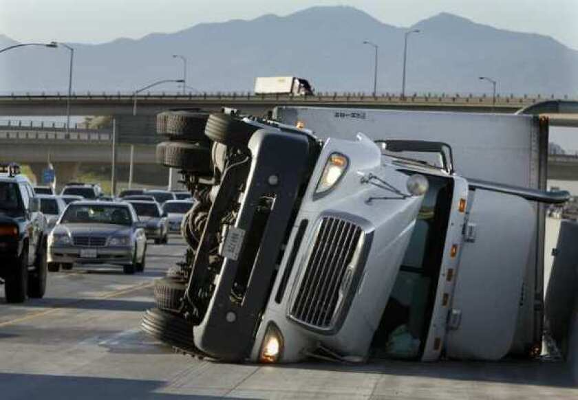 A toppled big rig in Ontario last year. The driver freed himself from the wreckage and complained of minor pain in his leg. Many others aren't so lucky.