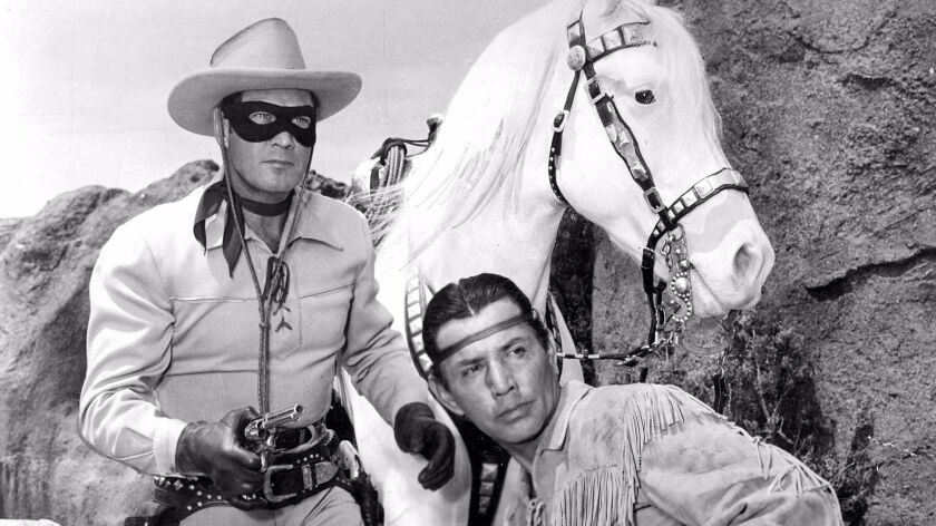"""Clayton Moore and Jay Silverheels in """"The Lone Ranger."""""""