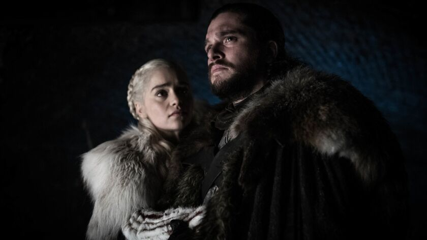 "This image released by HBO shows Emilia Clarke and Kit Harington in a scene from ""Game of Thrones,"""