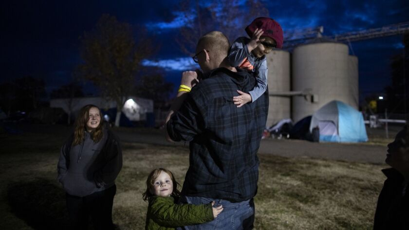 GRIDLEY, CA - NOVEMBER 26, 2018: Camp fire evacuees Suzie and Nathan Thomas with daughter Angel,5, W