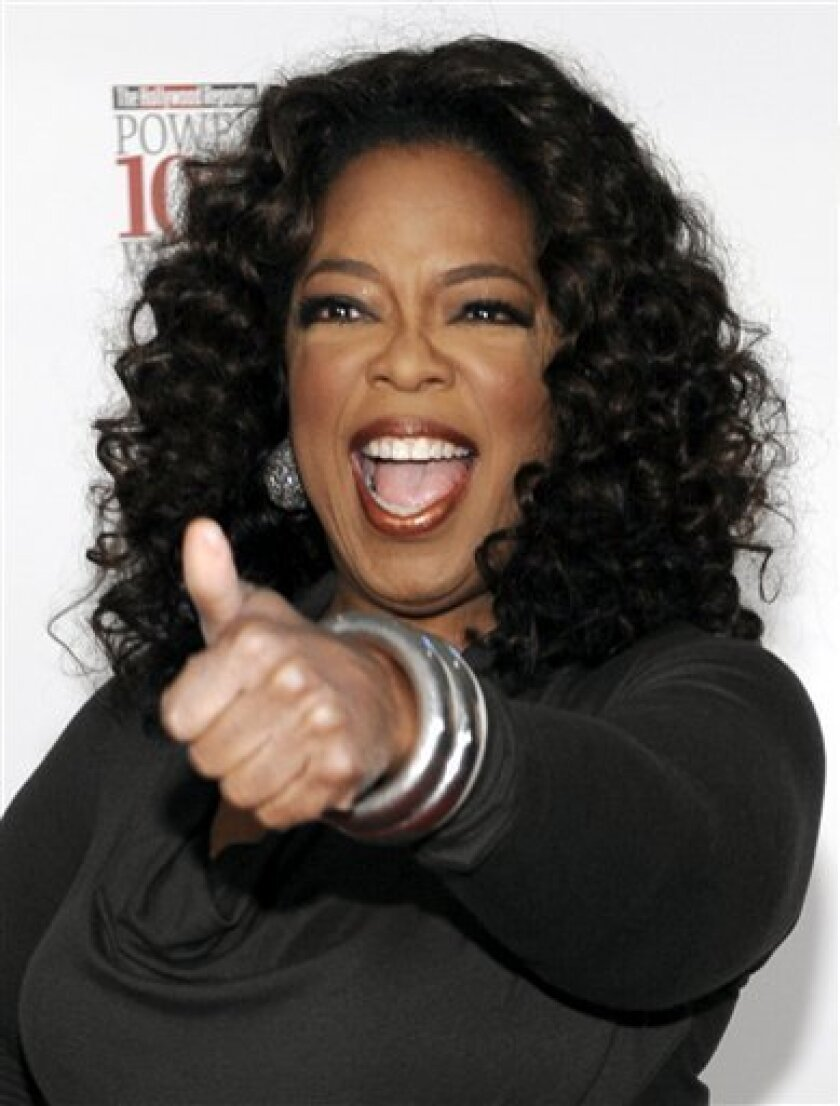 Oprah Winfrey poses at The Hollywood Reporter's annual Women in Entertainment Breakfast in Beverly Hills, Calif., Friday, Dec. 5, 2008. (AP Photo/Chris Pizzello)