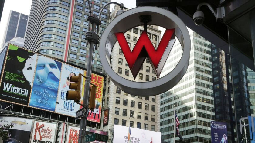 FILE - In this July 31, 2013, file photo, the logo for the W Hotel, owned by Starwood Hotels & Resor
