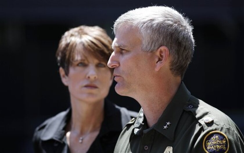 Border Patrol Chief Paul Beeson speaks about the death of Border Patrol Agent Luis Aguilar after a sentence was handed out in the cast Friday, July 1, 2011, in San Diego. At left, U.S. Attorney Laura Duffy looks on. Jesus Navarro was sentenced to life in prison for striking and killing Aguilar with a drug-laden Hummer in 2008 as the officer laid spike strips in an attempt to puncture the vehicle's tires. (AP Photo/Gregory Bull)