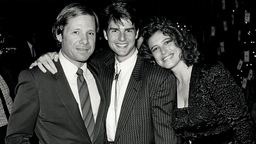 """Michael Ovitz with Tom Cruise and Cruise's first wife, Mimi Rogers, at the opening of """"The Color of Money."""""""