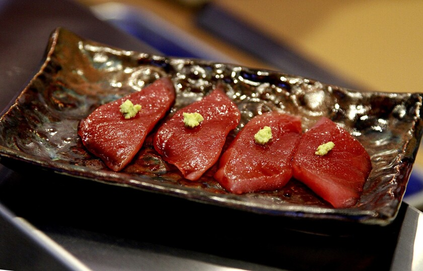Butter-soft tuna is served with a dab of grated wasabi.