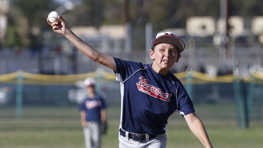 Joseph DiCarlo delivers a pitch for the Newport Harbor Baseball Assn. 11-and-under B team against Cypress in a St. Hedwig PONY Baseball All-Star Invitational game on Wednesday.