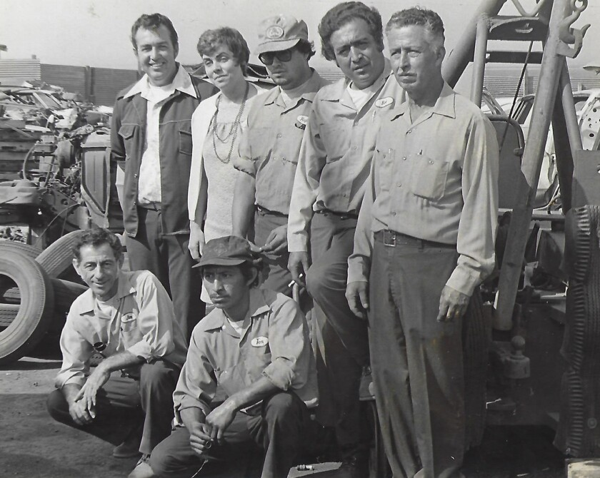 "Kathy Piland, second from left in the back row, with the staff at West Auto Wreckers in Chula Vista in the mid-1970s. At top left is ""Big Danny"" Street, who owned the business at the time."