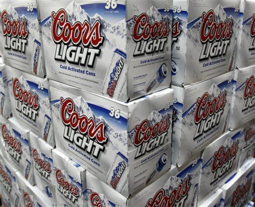 In this photo made Dec. 8, 2009, Coors Light is seen on display at Costco in Mountain View, Calif. Molson Coors said Tuesday, Feb. 9, 2010, its fourth-quarter profit more than doubled because of favorable tax benefits even as it sold fewer beers.(AP Photo/Paul Sakuma)