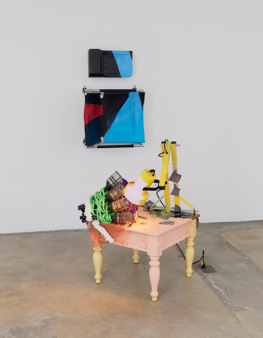 """""""And Server"""" by Jessica Stockholder, 2016. Table, garden light fixtures, rope, acrylic and enamel paint, industrial light fixture, plastic parts, hardware, industrial mesh, paper mache, taupe collared power bar, parts from printer and hard drives, 79 inches by 75 inches by 42 inches"""