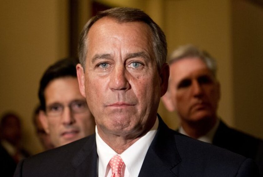 House Speaker John Boehner addresses the press at the U.S. Capitol in Washington. The White House budget director late Monday ordered federal agencies to begin closing down after Congress failed to pass a budget to avert a government shutdown.