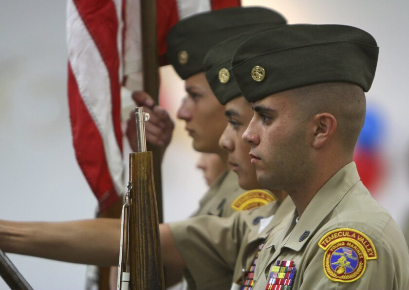 Murrieta Mesa High School student Robert Healey helps present the colors during a recent Young Marines recruitment ceremony at the Lake Elsinore Outlet malls.