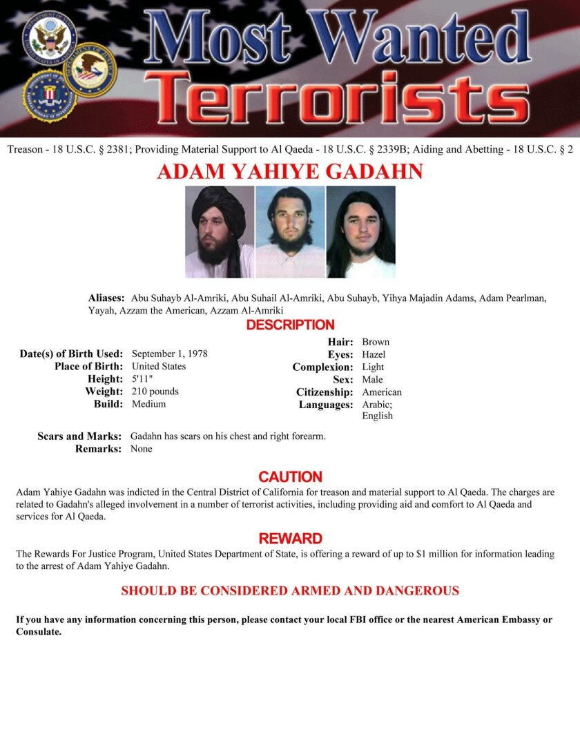 In this image released by the FBI, Adam Gadahn, an American who had served as a spokesman for al-Qaida, is seen in a wanted poster. An American and an Italian held hostage by al-Qaida, as well as two Americans working with the terror group, were inadvertently killed in U.S. counterterrorism operations in the border region between Afghanistan and Pakistan earlier this year, the White House said Thursday, April 23, 2015. U.S. officials have also concluded that Gadahn, an American who had served as a spokesman for the terror network, was killed in a separate operation in January. (FBI via AP)