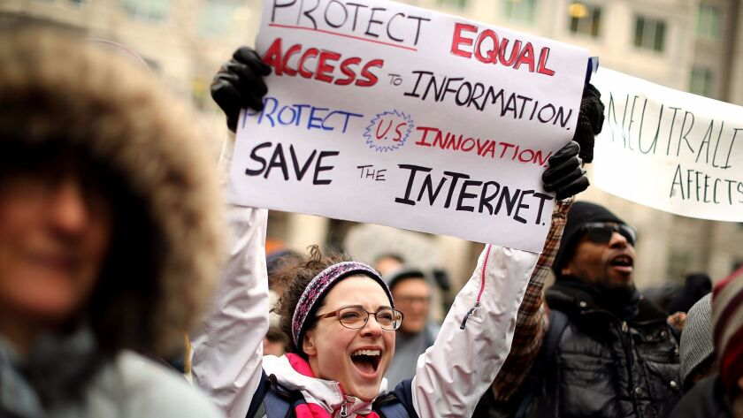 Demonstrators rally outside the Federal Communication Commission building Thursday to protest the repeal of net nutrality rules.