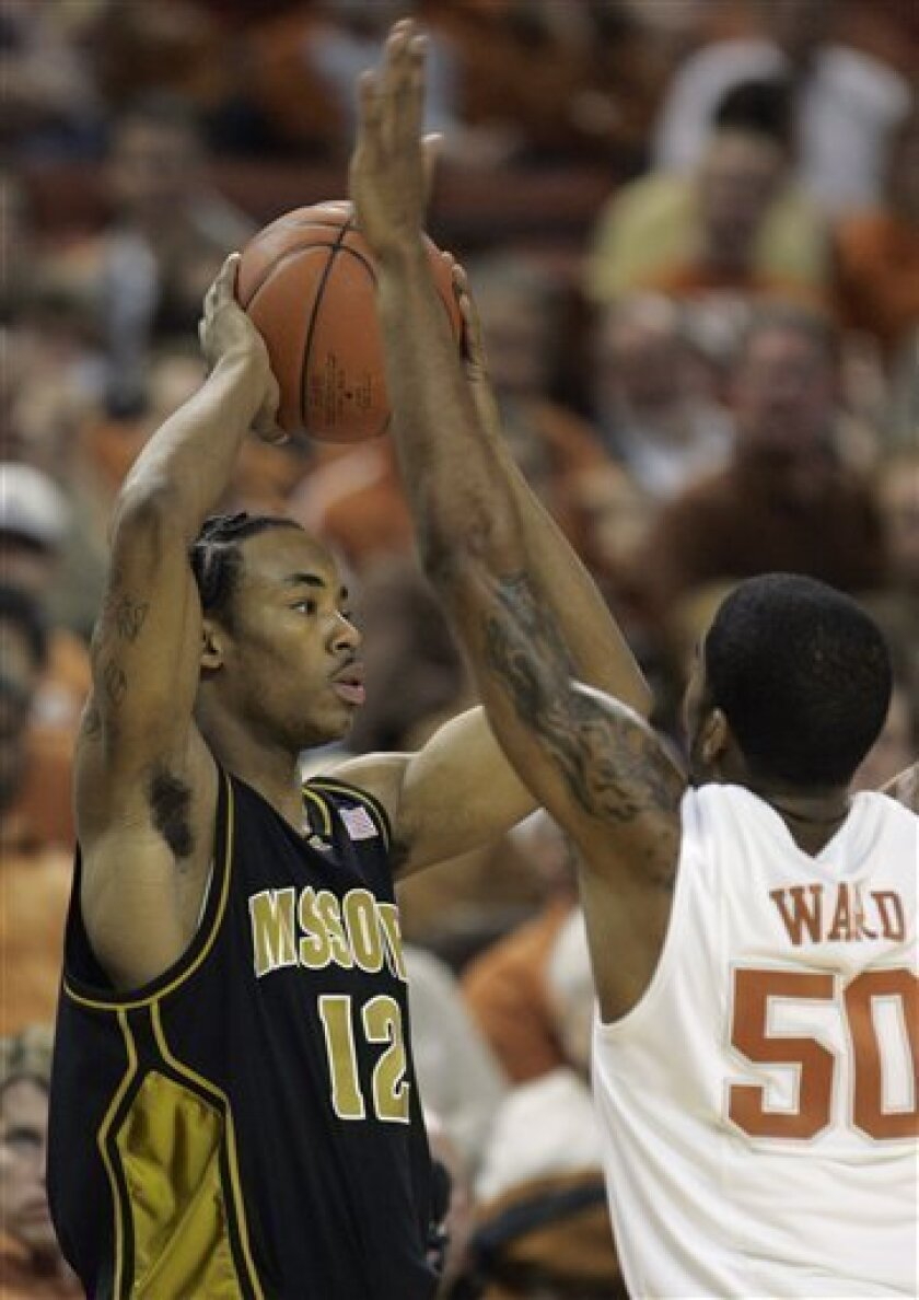 Missouri guard Marcus Denmon, left, is defended by Texas guard Varez Ward during the first half of an NCAA college basketball game Wednesday, Feb. 4, 2009, in Austin, Texas. (AP Photo/Harry Cabluck)