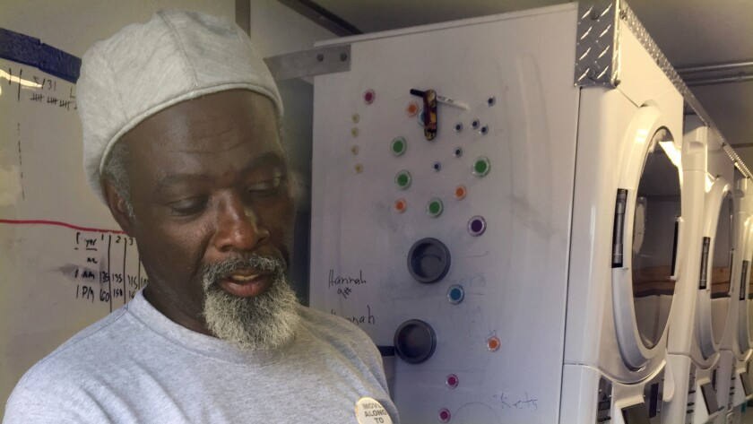 Marcus Harris, who was once homeless, runs the Laundry Truck, the mobile unit that washes clothes for Denver's homeless at no charge.