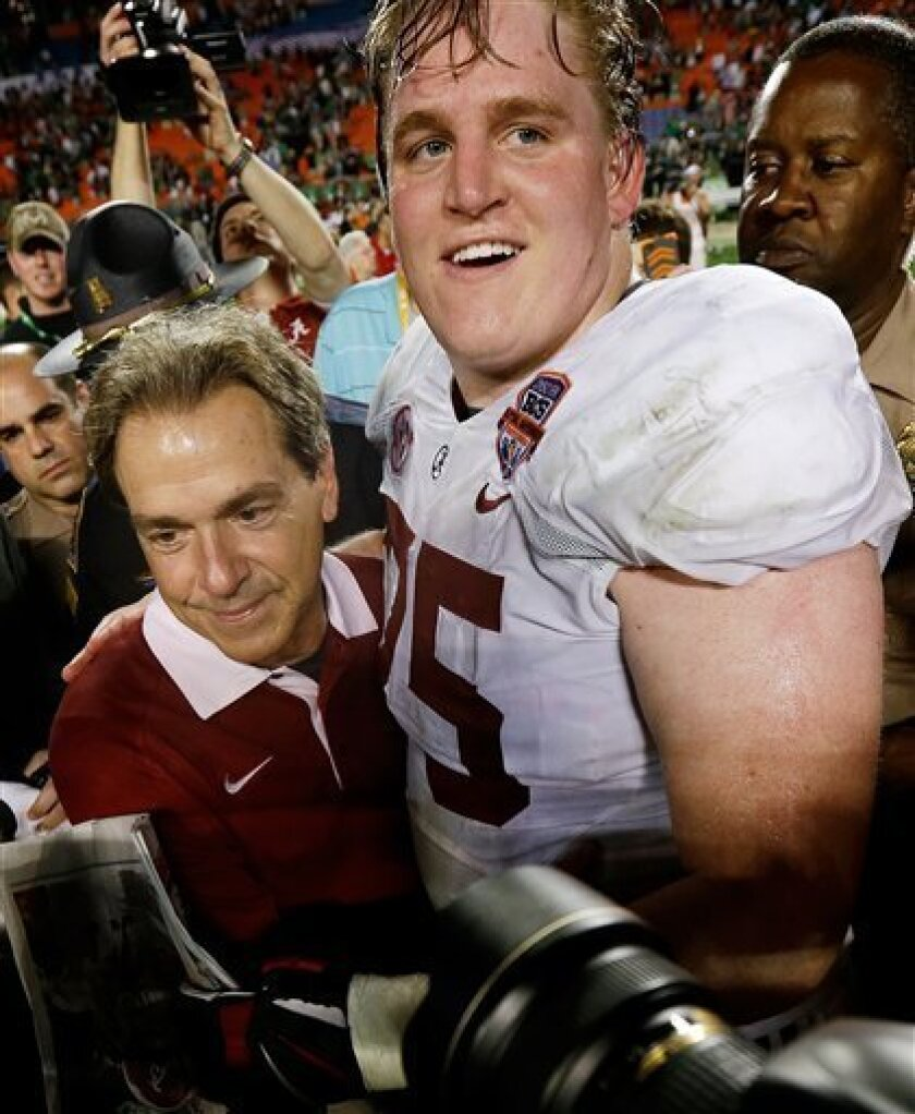 Alabama head coach Nick Saban celebrates with Barrett Jones after the BCS National Championship college football game against Notre Dame Monday, Jan. 7, 2013, in Miami. Alabama won 42-14. (AP Photo/David J. Phillip)
