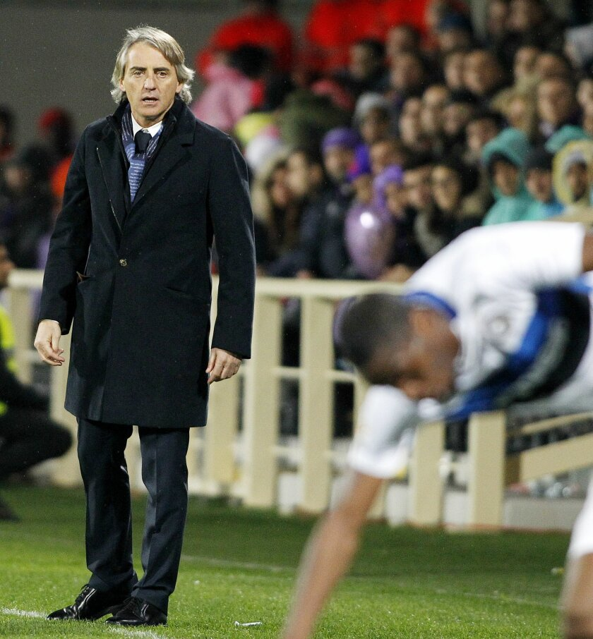 Inter coach Roberto Mancini looks in during a Serie A soccer match between Fiorentina and Inter Milan at the Artemio Franchi stadium in Florence, Italy, Sunday, Feb. 14, 2016. (AP Photo/Fabrizio Giovannozzi)