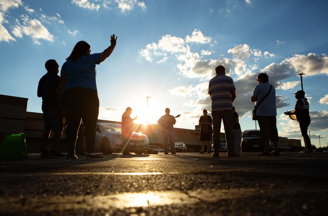 Donovan Price leads a prayer at a weekly service in a strip mall parking lot on Chicago's South Side.