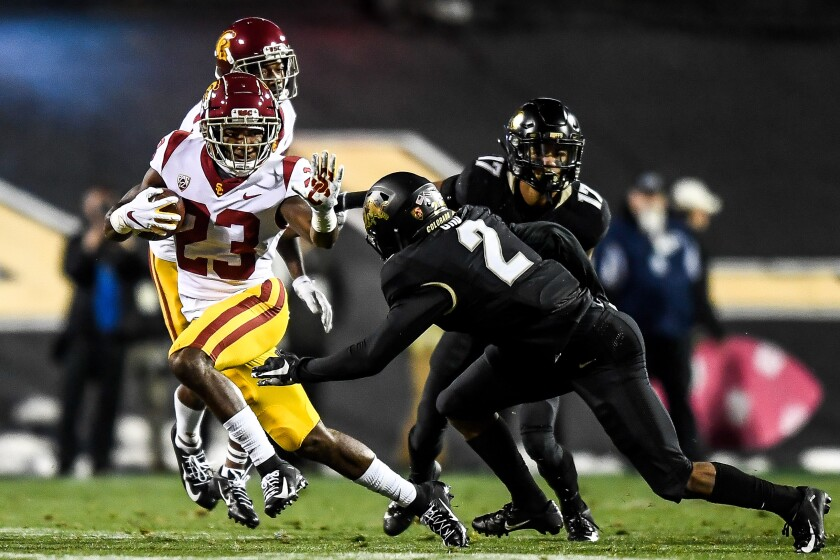USC running back Kenan Christon carries the ball during Friday's comeback win over Colorado.