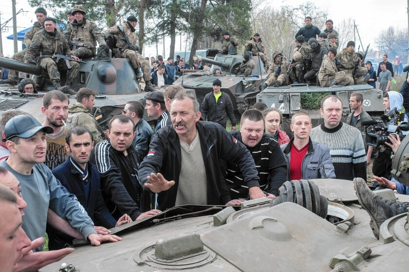 Pro-Russian protesters, who are demanding broader autonomy from Kiev and closer ties to Moscow, block Ukrainian tanks in Kramatorsk, eastern Ukraine, on Wednesday.