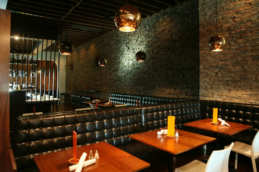 The black tufted banquet in the corner booths at Starlight add to the retro cool feel,