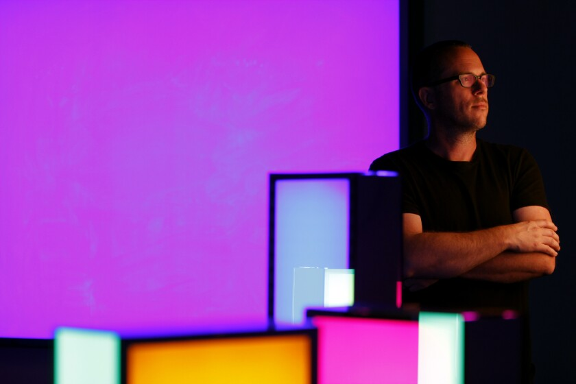 """Phillip K. Smith III in his studio in Indio. He has created an elaborate light installation, """"Refection Field,"""" debuting this weekend at Coachella."""