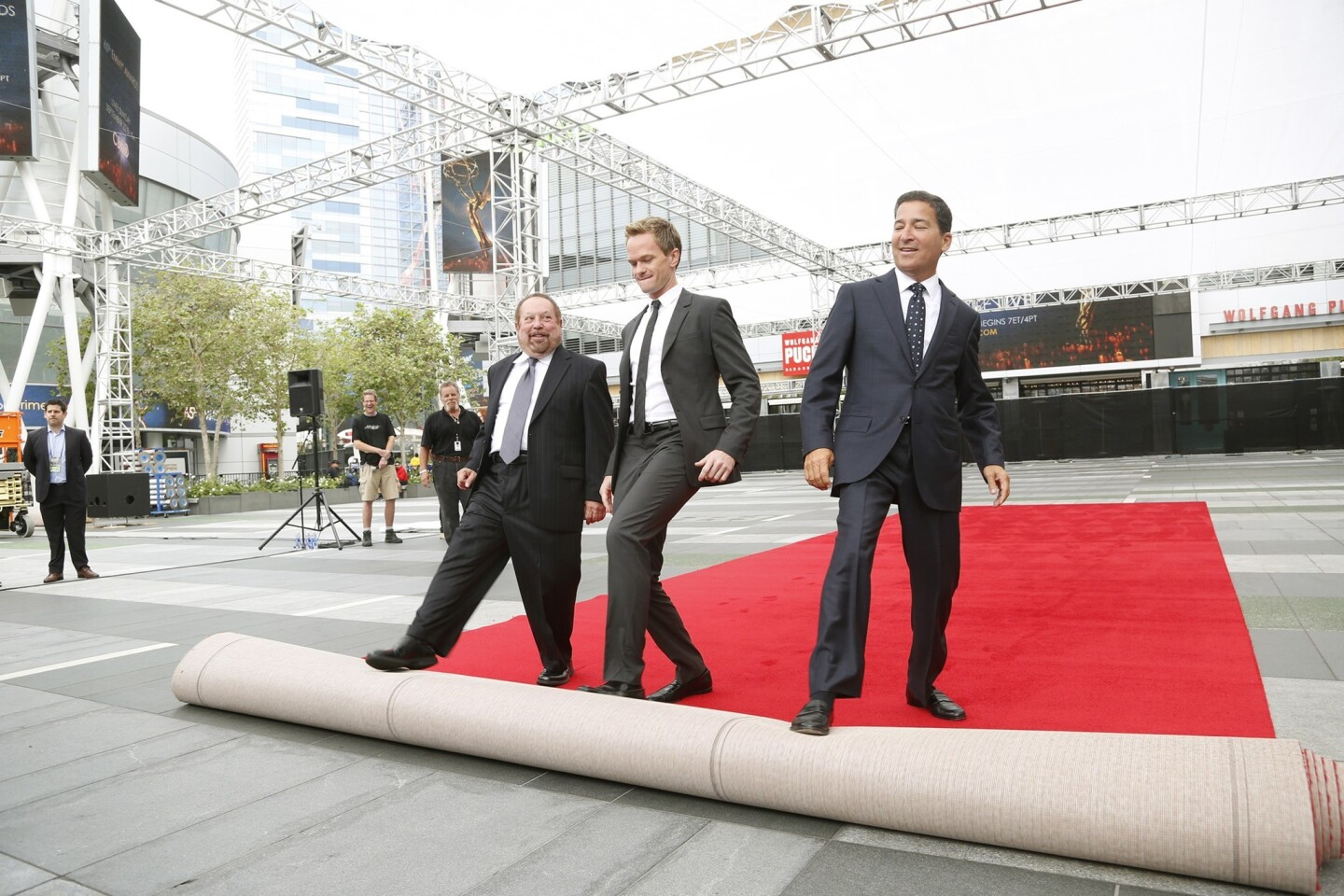 From left, Ken Ehrlich, Television Academy chairman and co-producer of this year's telecast; Neil Patrick Harris, this year's host and co-producer; and Academy of Television Arts & Sciences CEO Bruce Rosenblum roll out the red carpet for the 65th Primetime Emmy Awards at the Nokia Theatre Sunday, airing live on CBS at 5 p.m. PDT.